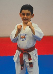Mason Cole, 8, struggled in sports until he discovered tae kwon do. Now he is working on his black belt.