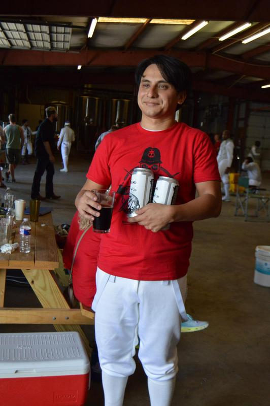 Carlos with his two beery prizes (for second place) and one post-tournament beer.