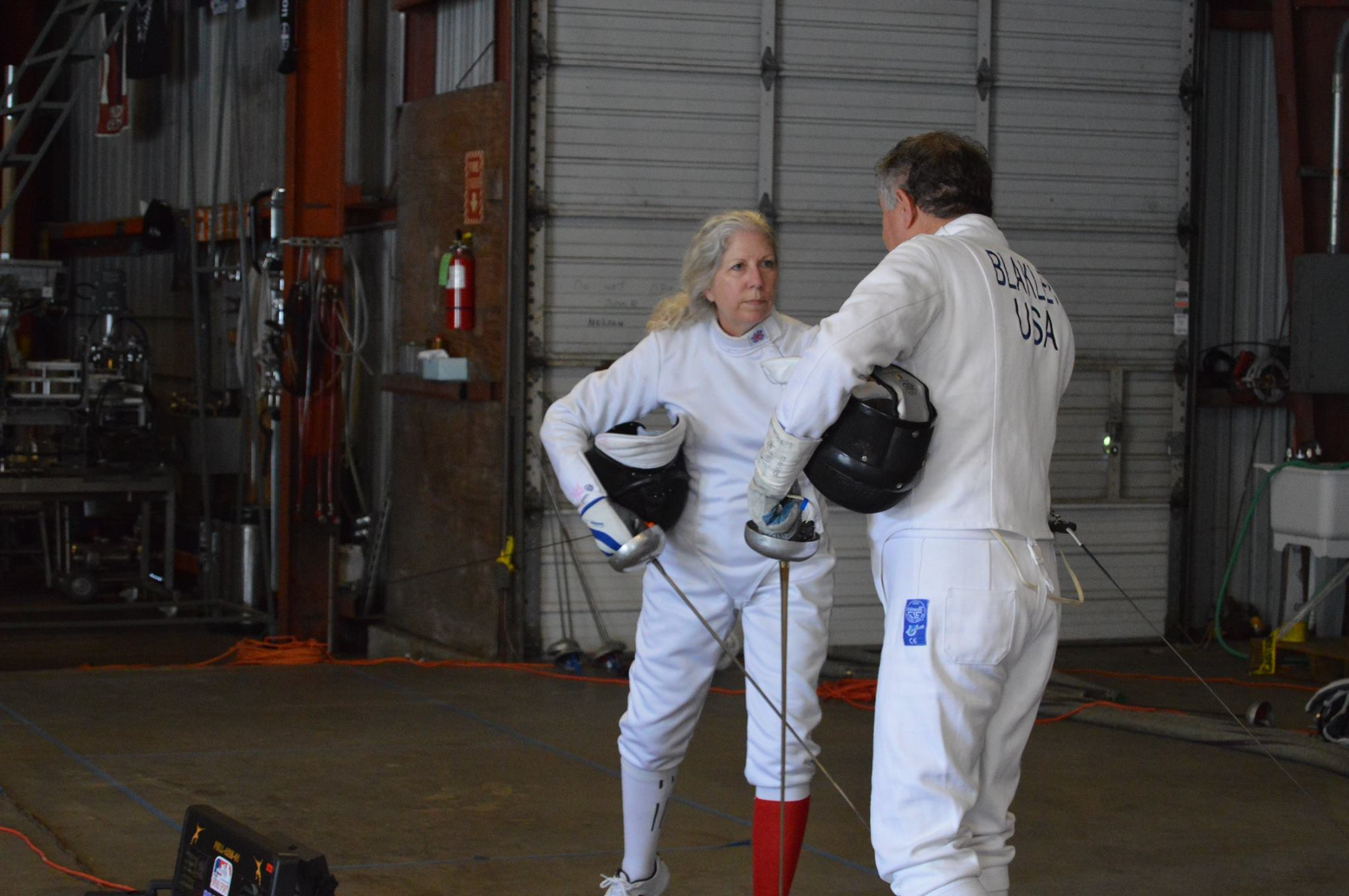 Kathy Howell Machol preparing to fencing