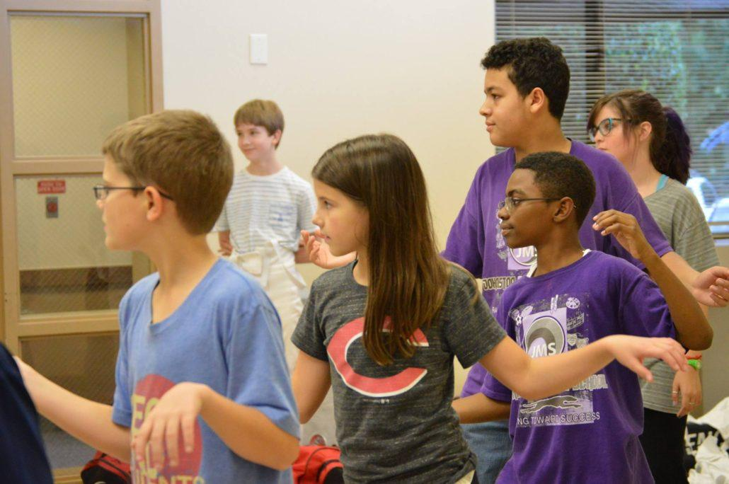 Fencers in a class at Bellaire learn to come en garde