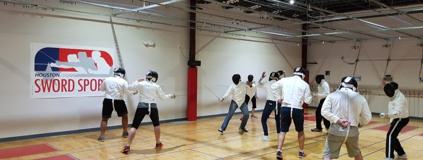 New fencers try out fencing for the first time at our grand opening.