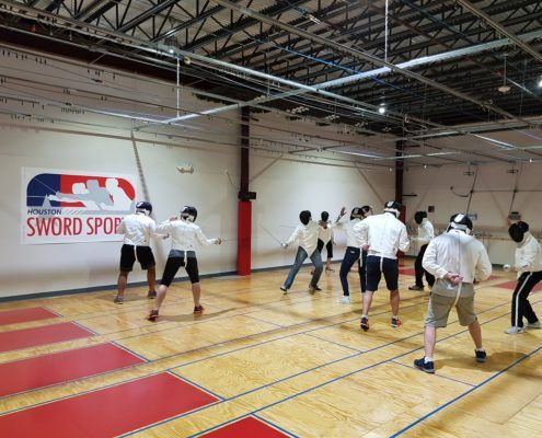Adult beginners prepare to fence