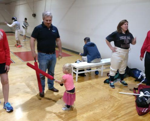 Oliver Diaz and his daughter train for future fencing classes