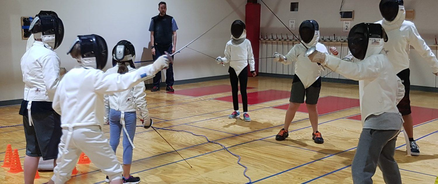 HSS Youth fencers play a fencing game