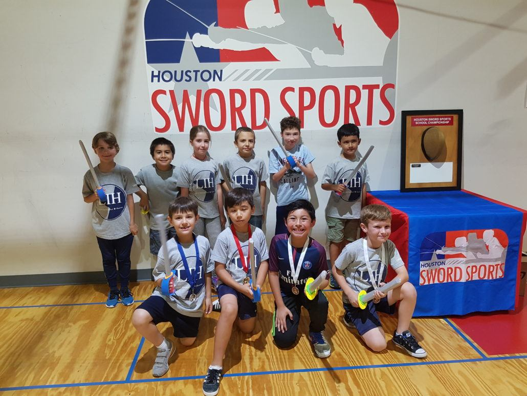 LIH fencers with their medals and foam swords