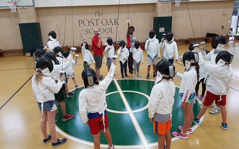 Post Oak School fencers salute at the end of practice