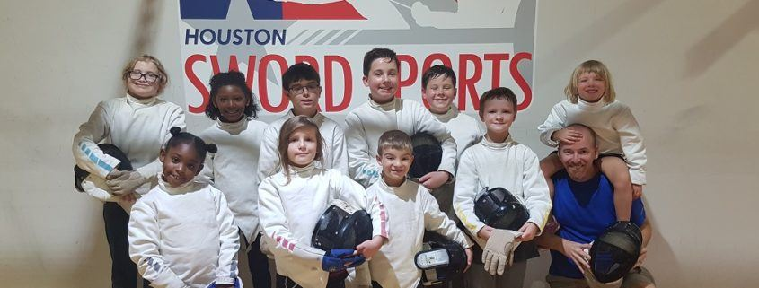 July 2018 Camp Participants pose by the Houston Sword Sports logo