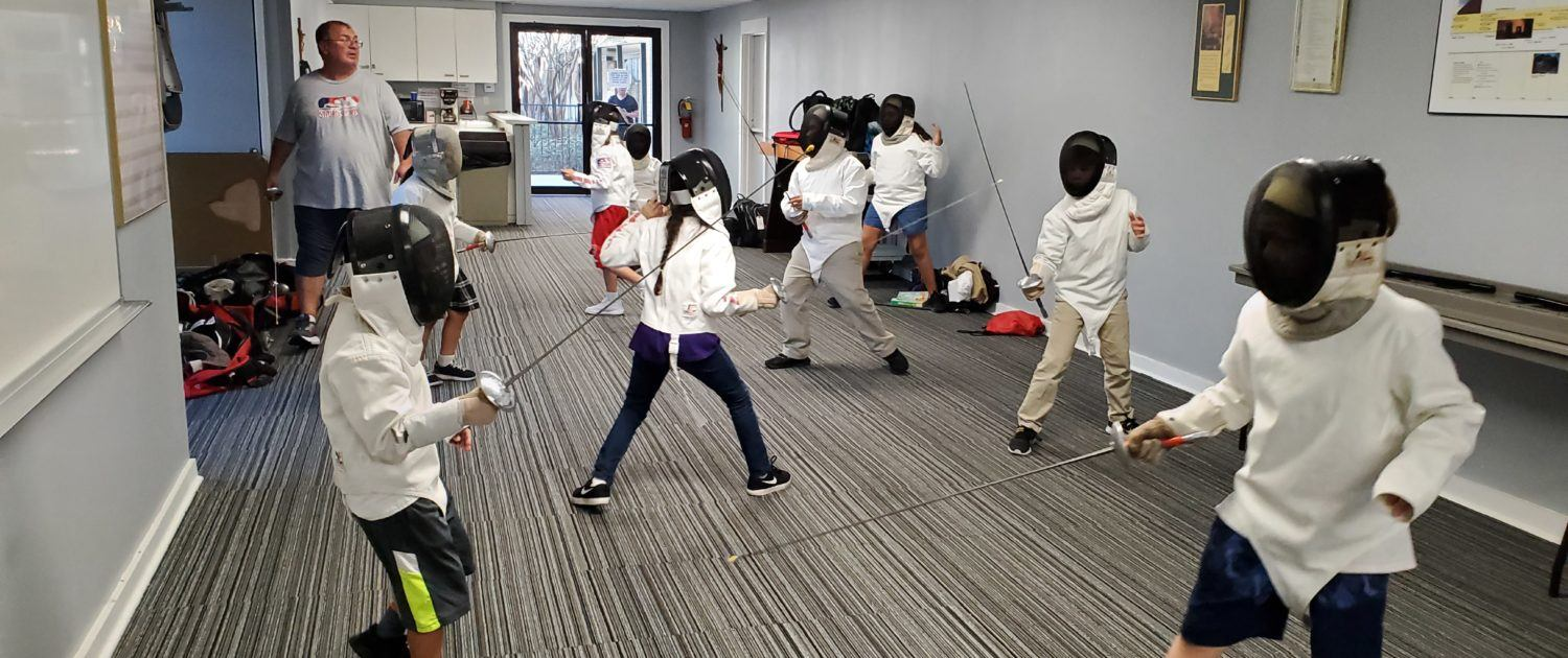 St. Thomas More students fencing foil