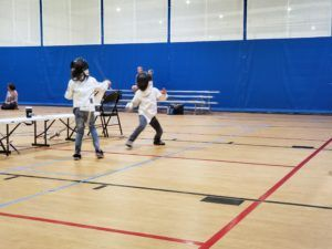 Two Y8 fencers compete