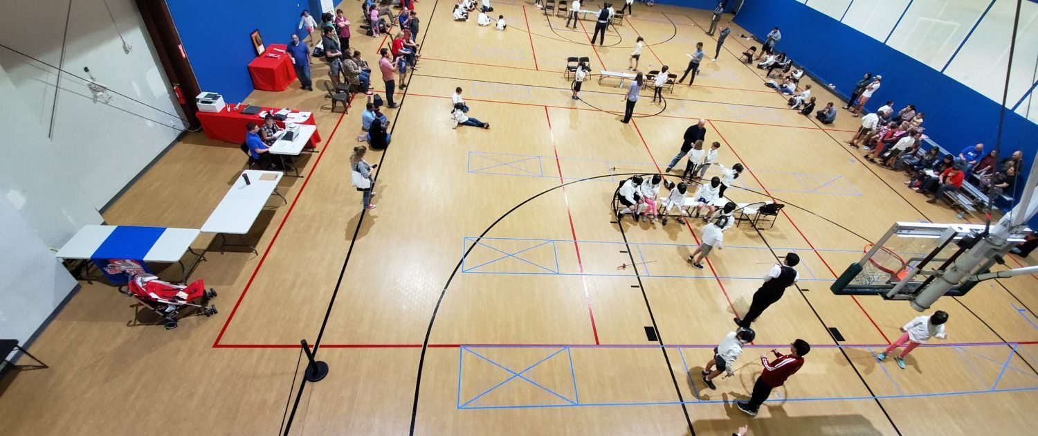 Y12/Y14 event, at the back of the gym, and Y10 event, middle and front, as seen from above.